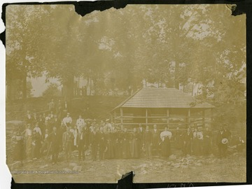 A large group of people get together at a pavilion in Webster Springs, a town known for its hot sulphur springs and large hotel.