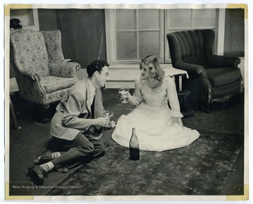 "Ann Little stars as the character Tracy Lord in a WVU production of ""Philadelphia Story,"" a play by Phillip Barry. The other character is played by Bob Brown."