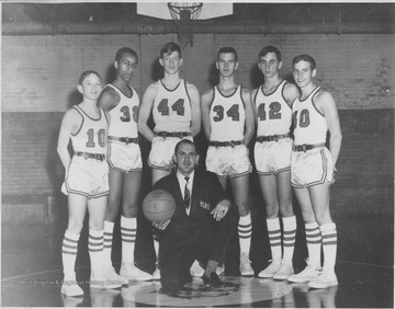 "Coach Tom Kurczak seated in frontStanding left to right Willie Barker, Duane Lewis, Rick ""Mouse"" Morris, Harold ""Swifty"" Shaver, Robert Thompkins, and Tim Thorn"